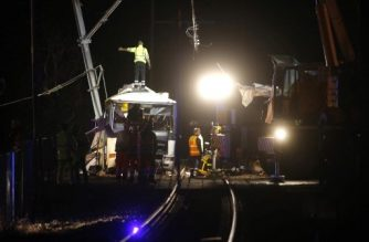 Firefighters and police work at the site of an accident in Millas, near Perpignan, southern France, on December 14, 2017, after a train crashed into a school bus at a level crossing. At least four children were killed and seven others seriously injured on December 14 after a train crashed into a school bus, police sources said. The bus, which was carrying around 20 students from a local secondary school, was struck by the train in Millas about 18 kilometres west (11 miles) of the city of Perpignan, close to the Spanish border. / AFP PHOTO / RAYMOND ROIG