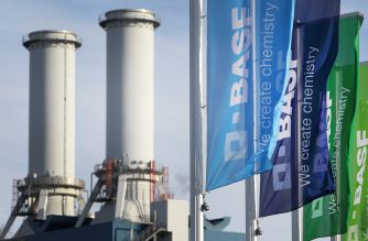 (FILES) Flags with the logo of German chemicals company BASF flutter in front of the company's headquarters in Ludwigshafen, western Germany, on February 24, 2017. / AFP PHOTO / Daniel ROLAND
