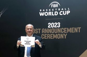 FIBA President Horacio Muratore shows the FIBA decision that the three-nation group of the Philippines, Japan and Indonesia will be the host of the 2023 FIBA Basketbal World Cup.  (Photo courtesy FIBA)