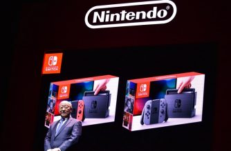 Japan's Nintendo Co. President Tatsumi Kimishima announces the company's new video game console Switch during a presentation in Tokyo on January 13, 2017.  Nintendo on January 13 unveiled its new Switch game console, which works both at home and on-the-go, as it looks to offset disappointing Wii U sales and go head to head with rival Sony's hugely popular PlayStation 4. / AFP PHOTO / Kazuhiro NOGI
