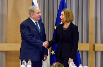 EU foreign policy chief Federica Mogherini greets Israeli Prime Minister Benjamin Netanyahu upon his arrival for their meeting at the European Council in Brussels on December 11, 2017.  Israeli Prime Minister Benjamin Netanyahu is ?holding talks on December 11 with EU foreign ministers, days after the US decision to recognise Jerusalem as Israel's capital, a move the premier had long sought but which has been met by widespread condemnation. / AFP PHOTO / POOL / ERIC VIDAL