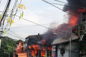 Flames are seen engulfing several houses in Alabang on Tuesday morning. /Gerry Fernandez/Eagle News Service/