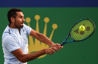 (FILES) Nick Kyrgios of Australia hits a return during the men's singles against Steve Johnson of America at the Shanghai Masters tennis tournament in Shanghai on October 10, 2017. / AFP PHOTO / CHANDAN KHANNA