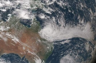 """This NOAA/JMA image obtained March 28, 2017 what the Japan Meteorological Agency's Himawari-8 satellite captured in this true-color image of Tropical Cyclone Debbie closing in on the northeastern coast of Australia at 0510 UTC, March 27, 2017.  A """"monster"""" cyclone smashed into northeast Australia March 28, 2017, cutting power, damaging buildings and uprooting trees, with coastal residents battling lashing rain and howling winds. Great Barrier Reef islands popular with foreign tourists were battered by the category four storm which slammed into the coast of Queensland state with destructive wind gusts of up to 270 kph (167 miles) near its broad core.  / AFP PHOTO / NOAA / Handout / RESTRICTED TO EDITORIAL USE - MANDATORY CREDIT AFP PHOTO /NOAA/JMA  - NO MARKETING - NO ADVERTISING CAMPAIGNS - DISTRIBUTED AS A SERVICE TO CLIENTS"""