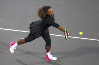 Serena Williams of the US Jelena returns the ball to Ostapenko of Latvia during the Mubadala World Tennis Championship 2017 match in Abu Dhabi, on December 30, 2017.  / AFP PHOTO / NEZAR BALOUT