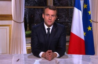 A videograb made on December 31, 2017 shows French President Emmanuel Macron delivering his New Years wishes from the Elysee palace in Paris.  / AFP PHOTO / -