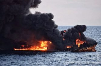 "This handout picture from the Transport Ministry of China released on January 14, 2018 shows smoke and flames coming from the burning oil tanker ""Sanchi"" at sea off the coast of eastern China.  An Iranian official said on January 14, 2018 there was no chance any crew members had survived among the 32 aboard an oil tanker on fire off the coast of China for more than a week.  / AFP PHOTO / Transport Ministry of China / -"