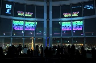 "This photo taken on January 15, 2018 shows Space Invaders GigaMax video game being displayed on the windows of the Roppongi Hills observatory, Tokyo City View during a Play Space Invaders exhibition in Tokyo. The aliens dropped down the window panes of a Tokyo skyscraper before being blasted into oblivion by enthusiastic gamers celebrating fourty years of the arcade sensation ""Space Invaders"". / AFP PHOTO / Kazuhiro Nogi"