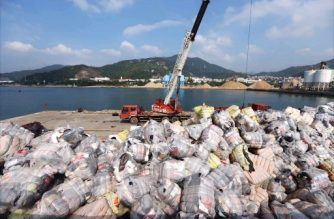 """This photo taken on November 17, 2016 shows Shenzhen Customs destroying illegally imported waste during a raid at a port in Shenzhen in China's southern Guangdong province. For years China was the world's top destination for recyclable trash, but a ban on certain imports has left nations scrambling to find new dumping grounds for growing piles of garbage. The decision was announced in July and came into force on January 1, 2018 giving companies from Europe to the United States barely six months to look for other options, and forcing some to store trash in parking lots.  / AFP PHOTO / - /  - China OUT / TO GO WITH AFP STORY """"CHINA-WASTE-RECYCLING"""" FOCUS BY BECKY DAVIS AND LILLIAN DING, WITH AFP BUREAUX IN EUROPE AND THE UNITED STATES"""