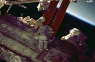 "This NASA TV video grab image shows NASA astronauts Mark Vande Hei(L) and Scott Tingle as they step out on a spacewalk to repair the robotic arm at the International Space Station. / AFP PHOTO / NASA TV / Handout / RESTRICTED TO EDITORIAL USE - MANDATORY CREDIT ""AFP PHOTO / NASA TV/HANDOUT"" - NO MARKETING NO ADVERTISING CAMPAIGNS - DISTRIBUTED AS A SERVICE TO CLIENTS"