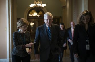 WASHINGTON, DC - JANUARY 21: Senate Majority Leader Mitch McConnell (R-KY) leaves the Senate floor and walks to his office on Capitol Hill, January 21, 2018 in Washington, DC. Lawmakers are convening for a Sunday session to try to resolve the government shutdown.   Drew Angerer/Getty Images/AFP