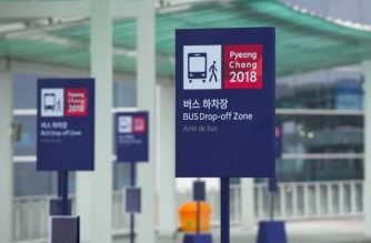 Bus stop signs for the 2018 PyeongChang Winter Olympics are seen at Terminal 2 of Incheon International Airport, west of Seoul, on January 18, 2018. Incheon airport, South Korea's top gateway, on January 18 opened its second terminal, three weeks before the opening of the Pyeongchang Olympics, airport authorities said. Terminal 2 houses four airlines -- South Korea's flag carrier Korean Air, Air France, Delta, and KLM Royal Dutch Airlines. / AFP PHOTO / JUNG Yeon-Je