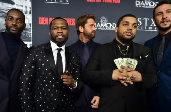 """(L-R) Actors Mo McRae, Curtis """"50 Cent"""" Jackson, Gerard Butler, O'Shea Jackson Jr. and Pablo Schreiber arrive for the premiere of the film """"Den of Thieves"""" in Los Angeles, California, on January 17, 2018. / AFP PHOTO / FREDERIC J. BROWN"""