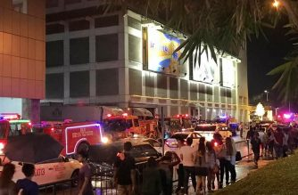 Firetrucks are on standby in the area of the Metro Cebu Ayala mall that was engulfed by fire on Saturday night, January 5, 2018./Raha fire volunteers Facebook/