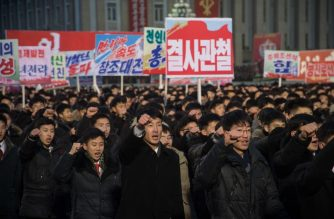 Participants gesture during a mass demonstration in support of a new year address made by North Korean leader Kim Jong-Un at Kim Il-Sung square in Pyongyang on January 4, 2018. / AFP PHOTO / KIM Won-Jin