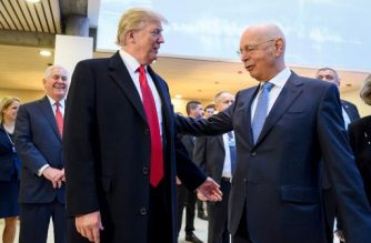 US President Donald Trump (L) speaks with Founder and Executive Chairman of the World Economic Forum (WEF) Klaus Schwab (R) upon his arrival to address the World Economic Forum (WEF) annual meeting on January 26, 2018 in Davos, eastern Switzerland. / AFP PHOTO / Fabrice COFFRINI