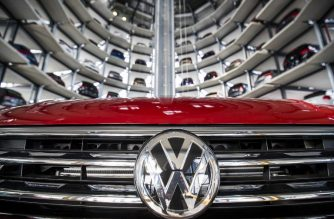 "(FILES) This file photo taken on March 14, 2017 shows German carmaker Volkswagen's cars at the storage facility auto tower at the company headquarters in Wolfsburg on March 14, 2017.    German carmaker Volkswagen said on January 17, 2018 it sold a record number of vehicles in 2017, putting it on track to hold on to the title of world's largest carmaker two years after its ""dieselgate"" emissions scandal. / AFP PHOTO / Odd ANDERSEN"