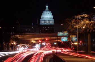 WASHINGTON, DC - JANUARY 22: The U.S. Capitol can be seen as traffic moves in and out of the city, on January 22, 2018 in Washington, DC. On day 3 of the government shutdown, lawmakers are convening to try to resolve their differences and reopen the government.   Mark Wilson/Getty Images/AFP