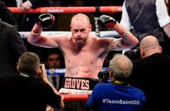 British boxer George Groves poses for photographers after defeating Italian boxer Andrea Di Luisa during their International Super-Middleweight contest in east London, England on January 30, 2016.  / AFP PHOTO / LEON NEAL