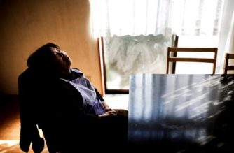 In this picture taken on January 10, 2017, dementia-stricken Kimiko Ito takes a nap while waiting for her husband to bring her lunch at their house in Kawasaki. One of the world's most rapidly aging and long-lived societies, Japan is at the forefront of an impending global healthcare crisis. Authorities are bracing for a dementia timebomb and their approach could shape policies well beyond its borders. / AFP PHOTO / BEHROUZ MEHRI / TO GO WITH Japan-society-ageing-dementia,FEATURE by Natsuko FUKUE