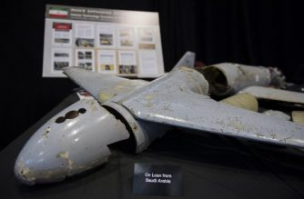 """A kamikaze drone is seen on display after US Ambassador to the United Nations Nikki Haley unveiled previously classified information intending to prove Iran violated UNSCR 2231 by providing the Houthi rebels in Yemen with arms during a press conference at Joint Base Anacostia in Washington, DC, on December 14, 2017. Haley said Thursday that a missile fired by Huthi militants at Saudi Arabia last month had been made in Iran. """"It was made in Iran then sent to Huthi militants in Yemen,"""" Haley said of the missile.  / AFP PHOTO / JIM WATSON"""