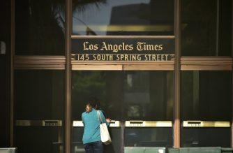 A woman enters the Los Angeles Times office building in Los Angeles, California on February 7, 2018, where billionaire Patrick Soon-Shiong reached a deal to buy the newspaper from Tronc, its Media Company owners. / AFP PHOTO / Frederic J. BROWN
