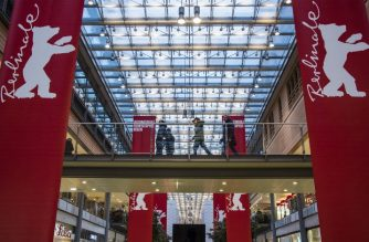 Berlinale film festival logos decorate a mall where tickets for the festival will be sold, in Berlin on February 11, 2018. This year's festival takes place from 15 to 25 February, with tickets going on sale from February 12th. / AFP PHOTO / John MACDOUGALL