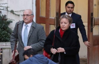 Oxfam's chief executive Mark Goldring (L) and Oxfam's chair of trustees Caroline Thomson leave the Department for International Development (DFID) in central London on February 12, 2018. Oxfam announced a new raft of measures to tackle sexual abuse cases after being ordered to meet the British government today to explain its handling of a 2011 prostitution scandal involving its aid workers in Haiti. / AFP PHOTO / Daniel LEAL-OLIVAS