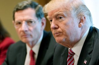 US President Donald Trump takes part in a meeting with bipartisan members of Congress on infrastructure in the Cabinet Room of the White House on February 14, 2018 in Washington, DC, as Senator John Barrasso, R-WY looks on. / AFP PHOTO / MANDEL NGAN