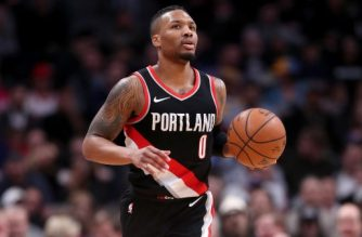 DENVER, CO - JANUARY 22: Damian Lillard #0 of the Portland Trail Blazers brings the ball down the court against the Denver Nuggets at the Pepsi Center on January 22, 2018 in Denver, Colorado. NOTE TO USER: User expressly acknowledges and agrees that, by downloading and or using this photograph, User is consenting to the terms and conditions of the Getty Images License Agreement.   Matthew Stockman/Getty Images/AFP