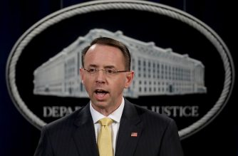 WASHINGTON, DC - FEBRUARY 16: U.S. Deputy Attorney General Rod Rosenstein announces the indictment of 13 Russian nationals and 3 Russian organizations for meddling in the 2016 U.S. presidential election February 16, 2018 at the Justice Department in Washington, DC. The indictments are the first charges brought by special counsel Robert Mueller while investigating interference in the election.   Win McNamee/Getty Images/AFP