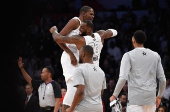 LOS ANGELES, CA - FEBRUARY 18: Kevin Durant #35 and LeBron James #23 of Team LeBron celebrate during the NBA All-Star Game 2018 at Staples Center on February 18, 2018 in Los Angeles, California.   Kevork Djansezian/Getty Images/AFP