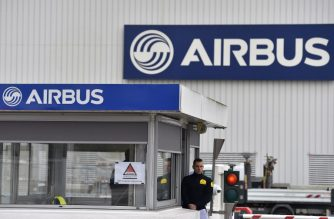 A picture taken on March 20, 2017 shows the entrance of the civil aircraft manufacturing company Airbus facility in Bouguenais, western France.   / AFP PHOTO / LOIC VENANCE