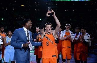 Bogdan Bogdanovic #8 of the World Team raises the 'Rising Stars Challenge MVP Trophy' with Chris Webber during the 2018 Mountain Dew Kickstart Rising Stars Game at Staples Center on February 16, 2018 in Los Angeles, California.   Kevork Djansezian/Getty Images/AFP