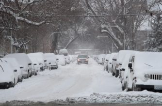 CHICAGO, IL - FEBRUARY 09: A motorist works his way down a snow-covered street after more than 7 inches of snow fell on February 9, 2018 in Chicago, Illinois. The city is bracing for upwards to 6 more inches before the weather system passes through the area on Sunday.   Scott Olson/Getty Images/AFP
