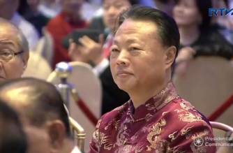 Chinese Ambassador to the Philippines Zhao Jianhua intently listens to President Rodrigo Duterte's speech during the the 10th Biennial National Convention and 20th Founding Anniversary Celebration of the Chinese Filipino Business Club, Inc. (CFBCI) at the Fiesta Pavillion of the Manila Hotel on February 19, 2018.