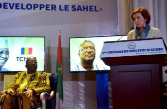 French Defence Minister Florence Parly (R) delivers a speech next to Burkina Faso's President Roch Marc Christian Kabore, during a G5 Sahel summit in Niamey, Niger on Febuary 6, 2018. Leaders of five Sahel countries met with France's defence minister on February 6, 2018 to discuss funding for an unprecedented joint force to combat jihadism in their vulnerable region.  / AFP PHOTO / BOUREIMA HAMA