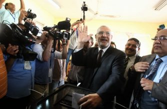 (FILE) Egyptian moderate Islamist presidential candidate Abdel Moneim Abul Fotouh casts his ballot at a polling station in Cairo on May 23, 2012, during the country's historic presidential election, the first since a popular uprising toppled Hosni Mubarak. AFP PHOTO/KHALED DESOUKI