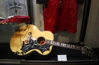 (FILES) In this file photo taken on June 22, 2016 Elvis Presley's limited edition Gibson EJ-200E guitar is displayed during a media preview at Heritage Auctions in Beverly Hills, California. Gibson, whose instruments have been played by the likes of John Lennon and Elvis Presley, is facing serious financial problems that threaten its very existence. Gibson Brands, which also sells audio systems for both professionals and the general public, is working with an investment bank to set up a debt refinancing plan, the company said in a statement. The group has a $375 million debt payment due in early August 2018, the Nashville Post reported. / AFP PHOTO / Tommaso Boddi