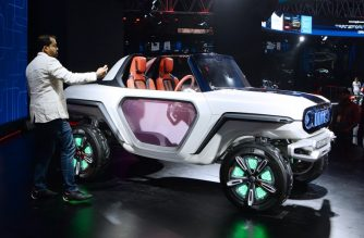 This photograph taken on February 7, 2018 shows a Maruti Suzuki electric e-Survivor concept car during the Indian Auto Expo 2018 in Greater Noida. Electric cars have basked in the limelight at the flagship auto show in India, where an ambitious plan to phase out polluting clunkers has manufacturers racing to lure millions of new drivers to their green vehicles. / AFP PHOTO / SAJJAD HUSSAIN / TO GO WITH India-economy-auto-AutoExpo2018,FOCUS by Abhaya Srivastava