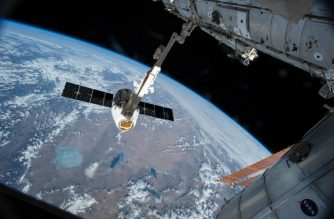 """(FILES) This NASA image taken April 17, 2015, shows the Canadarm 2 reaching out to grapple the SpaceX Dragon cargo spacecraft and prepare it to be pulled into its port on the International Space Station (ISS).  The White House hopes to end funding for and privatize the ISS, The Washington Post reported on February 12, 2018. """"The decision to end direct federal support for the ISS in 2025 does not imply that the platform itself will be deorbited at that time,"""" says an internal NASA document obtained by the Post. / AFP PHOTO / NASA / HO / RESTRICTED TO EDITORIAL USE - MANDATORY CREDIT """"AFP PHOTO / NASA"""" - NO MARKETING NO ADVERTISING CAMPAIGNS - DISTRIBUTED AS A SERVICE TO CLIENTS"""