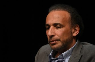 "(FILES) This file photo taken on March 26, 2016 shows Swiss Islamologist Tariq Ramadan takes part in a conference on the theme ""Live together"", in Bordeaux. State prosecutor's office asked for the detention of Islamic scholar Tariq Ramadan, over claims by two women that he raped them in French hotel rooms in 2009 and 2012, according to information from a legal source released on February 2, 2018. / AFP PHOTO / MEHDI FEDOUACH"