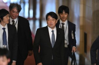 Japan's Defence Minister Itsunori Onodera (2nd R) arrives at parliament to attend a session of the House of Representatives Budget Committee in Tokyo on February 5, 2018. A Japanese military helicopter crashed on February 5 in a town in the southwest of the country, local media reported, with no immediate information on the fate of the pilot or any casualties. / AFP PHOTO / Kazuhiro NOGI