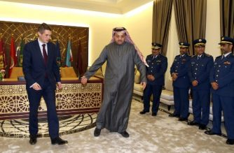Qatar's Defence Minister Khalid bin Mohammed al-Attiyah (C) receives his British counterpart Gavin Williamson (L) in the capital Doha on December 10, 2017, as Qatar signed an $8-billion (6.8-billion-euro) to buy 24 Typhoon fighters from Britain. Williamson said it was the biggest order for Typhoons in a decade, and it follows a billion-dollar deal signed by Qatar on December 7 to buy 12 French Dassault Aviation warplanes. The deal also includes an intention for Qatar to buy further military equipment from Britain, namely the purchase of Hawk aircraft. / AFP PHOTO / STRINGER