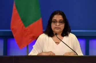 """In this handout picture obtained from the Maldivan Presidents Office on February 5, 2018 Presidential aide Azima Shukoor speaks during a TV broadcast announcing a state of emergency in Male.  Maldives President Abdulla Yameen declared a 15-day state of emergency on February 5, 2018, deepening a political crisis in the country that has pitted its leader against the nation's top court. / AFP PHOTO / MALDIVAN PRESIDENTS OFFICE / HO / RESTRICTED TO EDITORIAL USE - MANDATORY CREDIT """"AFP PHOTO / MALDIVAN PRESIDENTS OFFICE"""" - NO MARKETING NO ADVERTISING CAMPAIGNS - DISTRIBUTED AS A SERVICE TO CLIENTS"""