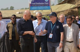Swiss President Alain Berset (3rd L) meets Peter Guest, head of the United Nation's World Food Programme in Cox's Bazar, on his visit to the Kutupalong refugee camp for Rohingya refugees who have fled Myanmar for Bangladesh, on February 6, 2018. / AFP PHOTO / Suzauddin Rubel