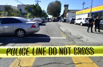 """Police stand at a roadblock near Salvadore Castro Middle School in Los Angeles, California on February 1, 2018, where two students were wounded, one critically, in a school shooting.  Two 15-year-old students in Los Angeles were shot and wounded in class Thursday, according to witnesses and local media, in the latest school shooting to hit the United States. A boy was shot in the head, while a girl was hit in the wrist, according to reports from the scene. Local news agency CNS reported that a """"young woman,"""" possibly a fellow student, had been arrested.   / AFP PHOTO / Frederic J. Brown"""