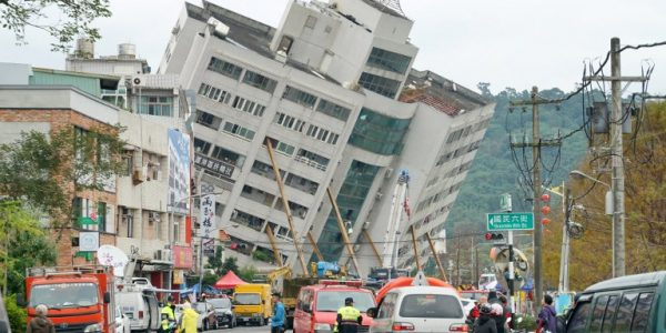 News in photos:  Support girders prop up a building left tilting after 6.4 magnitude Taiwan quake