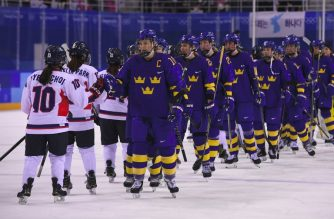 Team Sweden (R) shake hands with the Unified Korea team after their women's play-off classifications (7-8) ice hockey match between the Unified Korea team and Sweden during the Pyeongchang 2018 Winter Olympic Games at the Kwandong Hockey Centre in Gangneung on February 20, 2018.   / AFP PHOTO / Jung Yeon-je