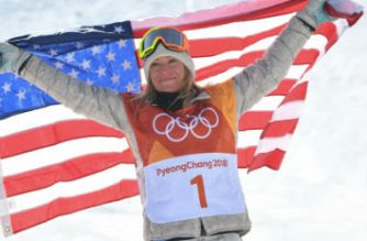 Gold medallist US Jamie Anderson celebrates during the victory ceremony after the women's snowboard slopestyle final event at the Phoenix Park during the Pyeongchang 2018 Winter Olympic Games on February 12, 2018 in Pyeongchang.  LOIC VENANCE / AFP